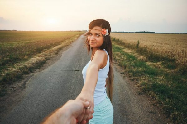 Young woman leading man