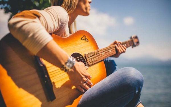 11 Woman playing guitar