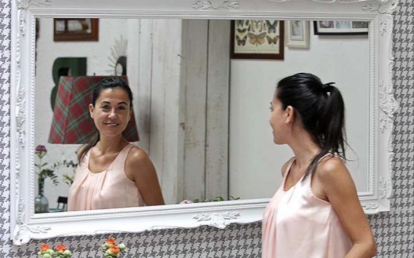 15 Woman looking at herself in the mirror