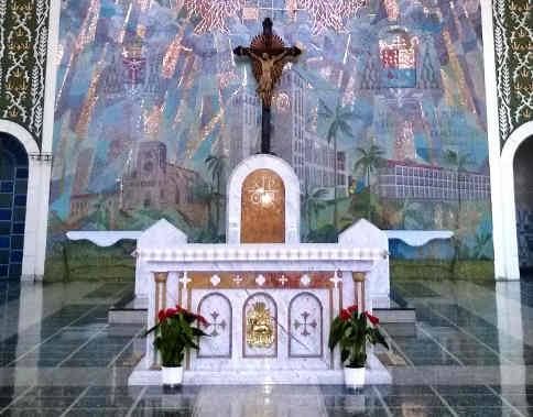 why does the priest kiss the altar catholic church