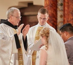 The Nuptial Blessing is a rather lengthy prayer is tucked between the Exchange of Consent and the Our Father Catholic Wedding ceremony